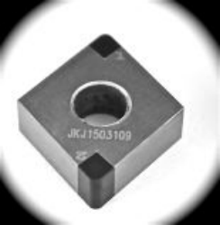 Solid PCBN inserts for processing chilled steel and iron